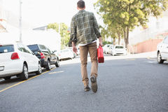 Man bringing petrol canister to a broken down car. In the street stock photo