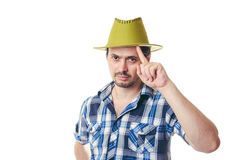 The man with a bristle in green a hat Stock Images