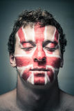 Man with British flag on face and closed eyes Royalty Free Stock Photos