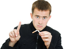 A man broke his cigarette. Royalty Free Stock Photography