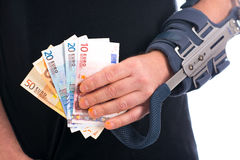Man with broken arm and euros Stock Image