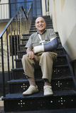 Man With Broken Arm Sitting On Stairs Royalty Free Stock Photo