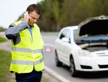 Man and broken car on a roadside Royalty Free Stock Photo