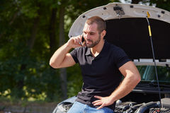 Man with a broken car Royalty Free Stock Photo