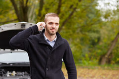 Man with a broken car Stock Photography