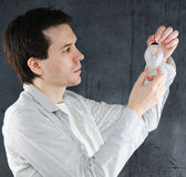 Man with the broken christmas ornament. Stock Images