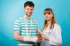 Man with broken hand visit doctor. Stock Image