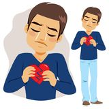 Man Broken Heart. Young sad man holding two pieces of broken heart crying Stock Photography