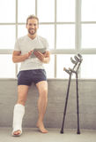 Man with broken leg Royalty Free Stock Photography