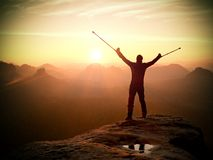 Man with broken leg and medicine crutch.  Hiker with leg in immobilizer achieve peak Stock Photos