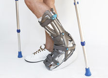 Man with a broken leg with Orthotic Stock Images