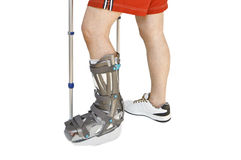 Man with a broken leg with Orthotic Royalty Free Stock Photos