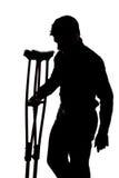 Man with broken leg Stock Image