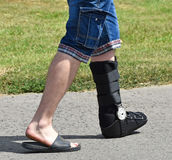 Man with broken leg. On the street royalty free stock photography