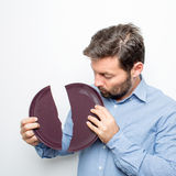 Man with a broken plate Royalty Free Stock Photography