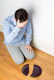 Man with a broken plate Stock Image