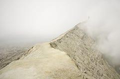 Man at Bromo Volcano. A man climbs the bromo volcano in vapor of sulfur. Tengger Semeru National Park Stock Photography
