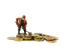 Man with broom. Brushes euro coins together Royalty Free Stock Photos