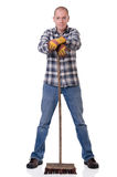Man with broom Royalty Free Stock Image