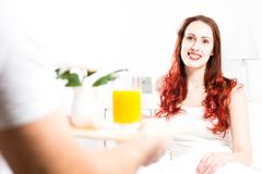 Man brought his girlfriend breakfast in bed Royalty Free Stock Photos
