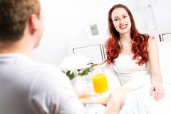 Man brought his girlfriend breakfast in bed Stock Image