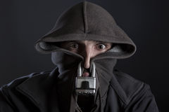Man brought to silence and censorship with padlock and hood. royalty free stock image