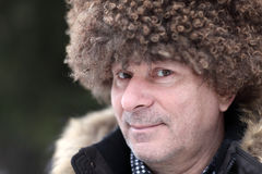 Man in brown caucasian hat. Portrait of man in brown caucasian hat Royalty Free Stock Photography