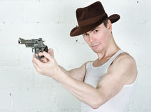 Man in brown hat with gun Royalty Free Stock Photography