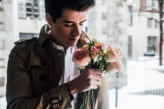 Man in Brown Jacket Holding Red and White Rose Stock Photography