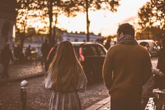 Man in Brown Jacket Beside Woman in Grey Jacket during Sunset Stock Image
