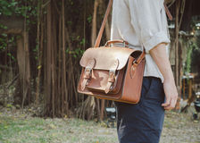 Man with brown leather bag Royalty Free Stock Photography