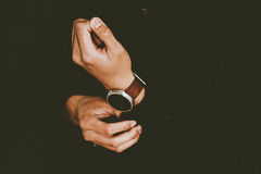 Man in Brown Leather Silver and Black Watch Stock Photography