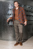 The man in brown pants and a checked jacket Royalty Free Stock Photos