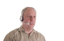 Man in Brown Shirt with Phone Headset Stock Photo