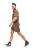 Man in brown uniform walking Stock Images