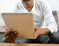Man browsing digital tablet computer Stock Photography