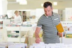 Man browsing in library. Man Stock Photos
