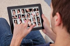 Man browsing pictures on digital tablet Royalty Free Stock Photo