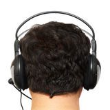 Man the brunette in ear-phones. Man the brunette in ear-phones, the rear view Stock Image