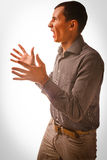 Man brunette experiencing anger emotions, Royalty Free Stock Photography