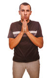 Man brunette prays Christianity hands together Royalty Free Stock Images