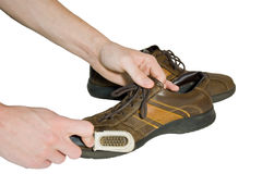Man brush shoes Stock Photo