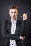 Man  with a brush. Stylish young handsome man in a suit with a brush Royalty Free Stock Photos