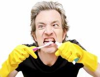 Man brushing dirty teeth stock image