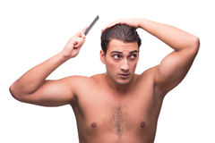 The man brushing his hair isolated on white Royalty Free Stock Photography