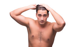 The man brushing his hair isolated on white Royalty Free Stock Images
