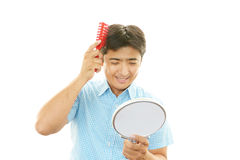 Man brushing his hair Stock Photo