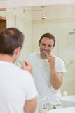 Man brushing his teeth Stock Photos
