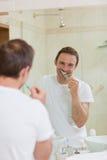 Man brushing his teeth Stock Photos