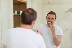 Man brushing his teeth Royalty Free Stock Photo